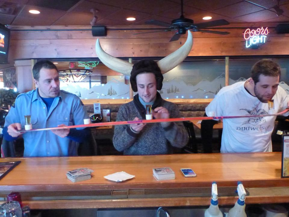 trying my first shot-ski (a shot attached to a ski) with Marco left and Chris right.